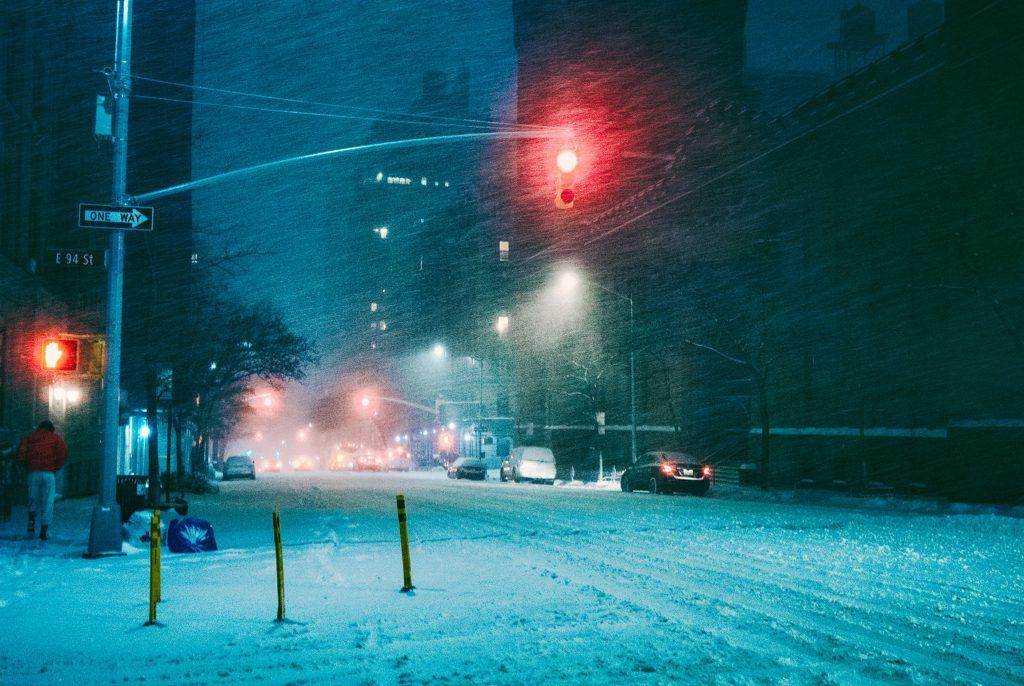 snowy city street traffic lights