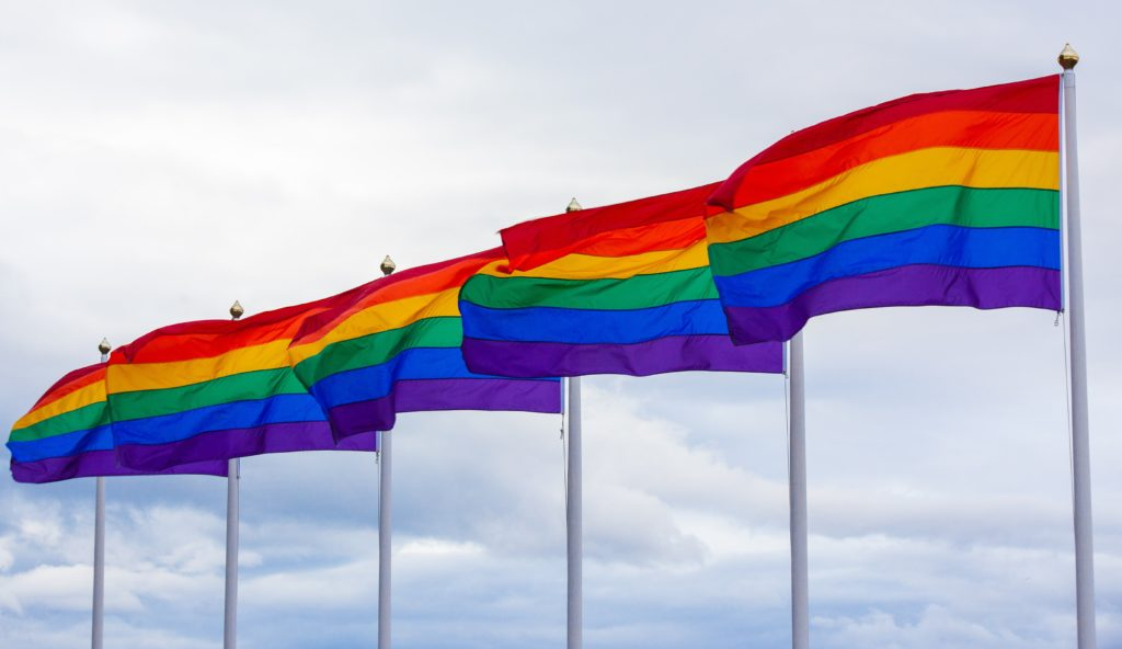 5 gay flags waiving in the wind