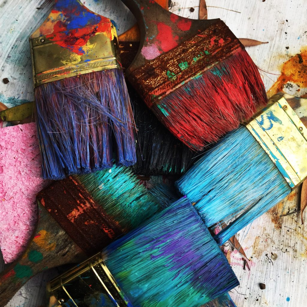 unwashed brightly colored paintbrushes signifying the war of art