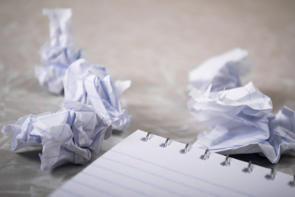 crinkled up paper and a pad