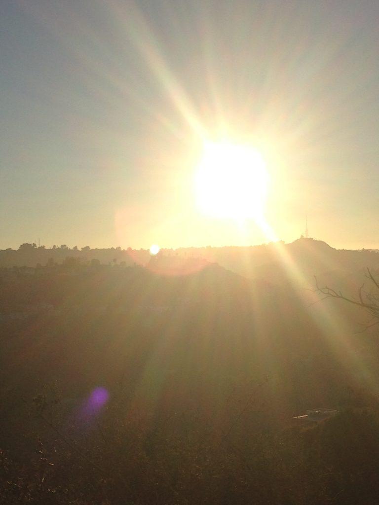 grey sunrise, white sun